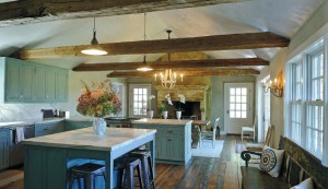 A new kitchen with family dining and adjacent screened porch replaced a carriage shed.
