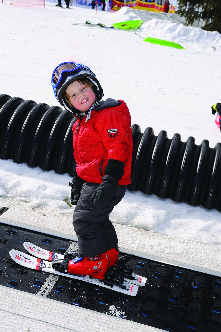 child on ski magic carpet