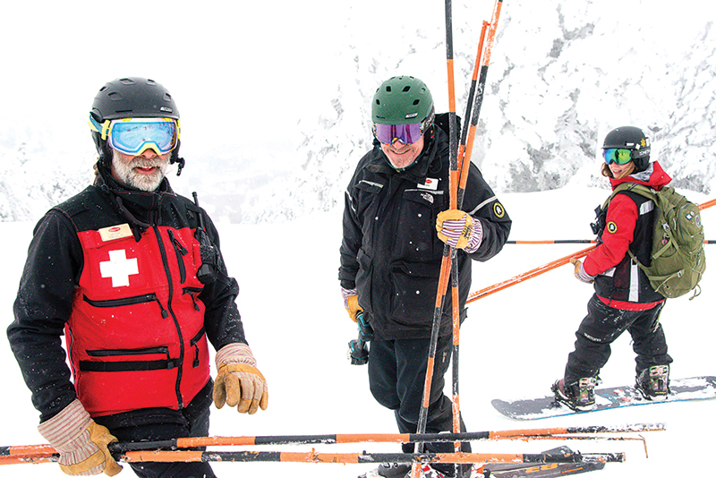 ski patrollers on the trails at stratton mountain